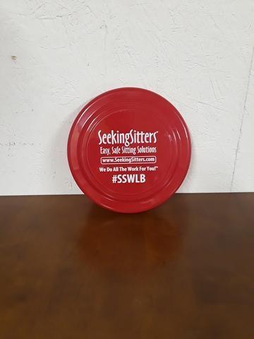 red seeking sitters frisbee